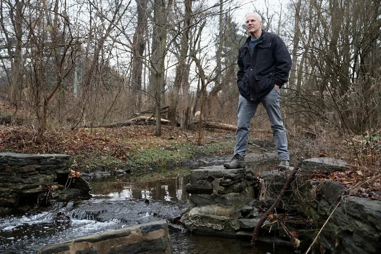 Adam Levine, a historical consultant for the Philadelphia Water Department, stands for a portrait next to Mill Creek at Merion Botanical Park in Lower Merion, Pa., on Friday, Feb. 8, 2019. Levine is giving a talk about the history of the city's sewer system.
