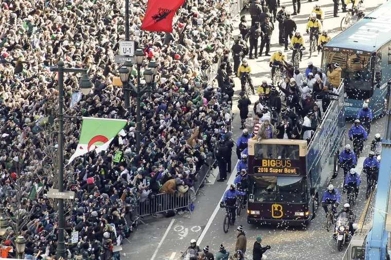 Buses carrying Eagles players make their way up the Parkway, to the Art Museum, during Thursday's Super Bowl parade.