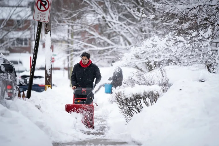 Andres Lopez clears the sidewalk in Norristown on Groundhog Day. He'll probably need that thing Thursday and Friday.