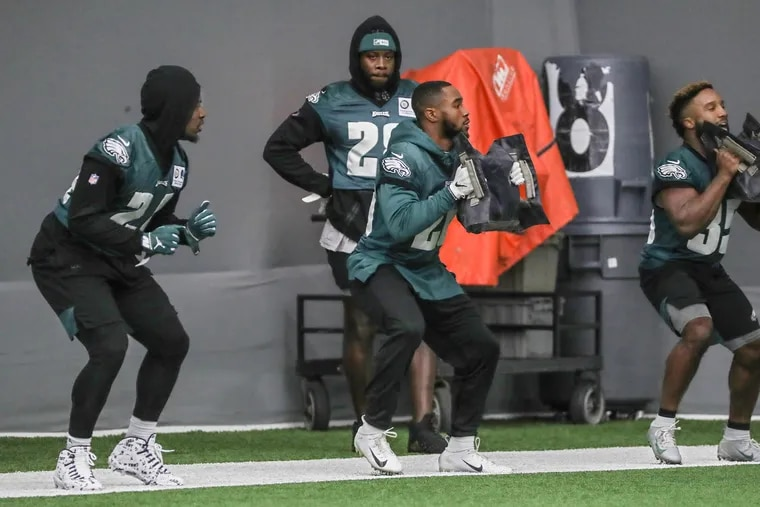 Eagles running backs (from left) Jordan Howard, Miles Sanders and Boston Scott participating in a drill last week, in front of the since-released Jay Ajayi.
