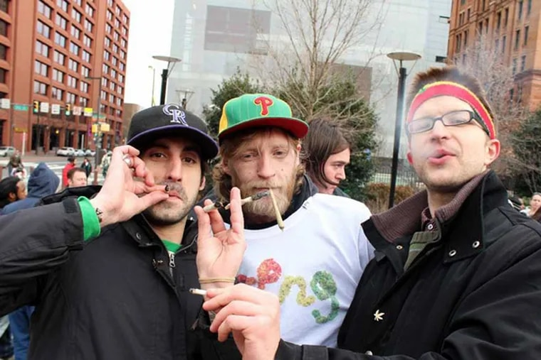 """NA Poe, Jim P., and Steve Miller light up at 4:20 during the """"Smoke Down Prohibition"""" event at Independence Hall."""
