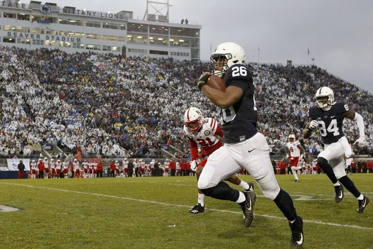 Saquon Barkley takes the ball 65 yards for a touchdown against Nebraska during the first half.
