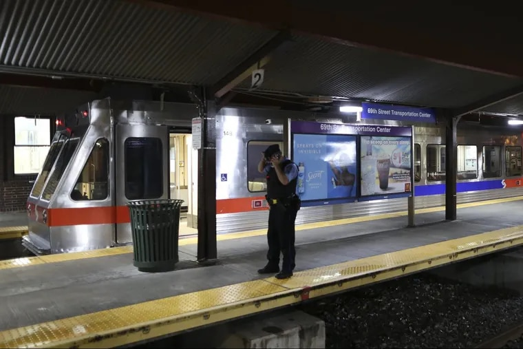 SEPTA officials look over damaged train cars on Tuesday Aug. 22, 2017, at the 69th Street Transportation Center in Upper Darby. According to SEPTA officials, a train from the Norristown High Speed Line arriving at the transportation center shortly after midnight struck an unoccupied train car that was sitting at the station platform, injuring more than two dozen people.