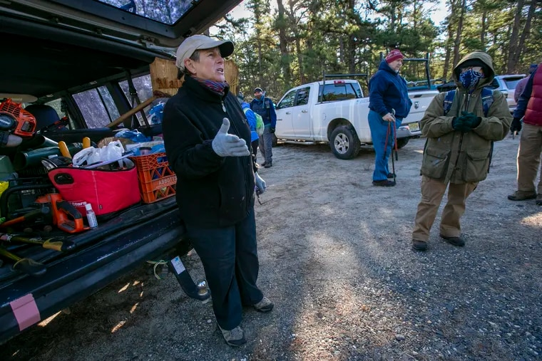 """Sisters Rosemarie """"Ro"""" Mason and Diane Mason at right led volunteers with Outdoor Club of South Jersey on a morning of trail maintenance near an entrance to the  51 mile Batona Trail in Pinelands region of New Jersey on Dec. 15."""