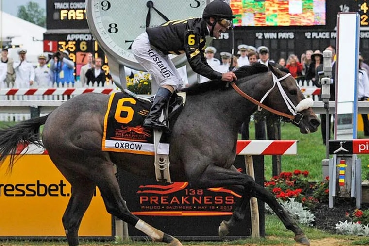 Oxbow, ridden by jockey Gary Stevens, wins the 138th Preakness Stakes horse race at Pimlico Race Course, Saturday, May 18, 2013, in Baltimore. (Mike Stewart/AP)