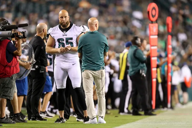 Eagles offensive tackle Lane Johnson (65) on the sideline during the fourth quarter of the preseason game against the New England Patriots at Lincoln Financial Field on Aug. 19.