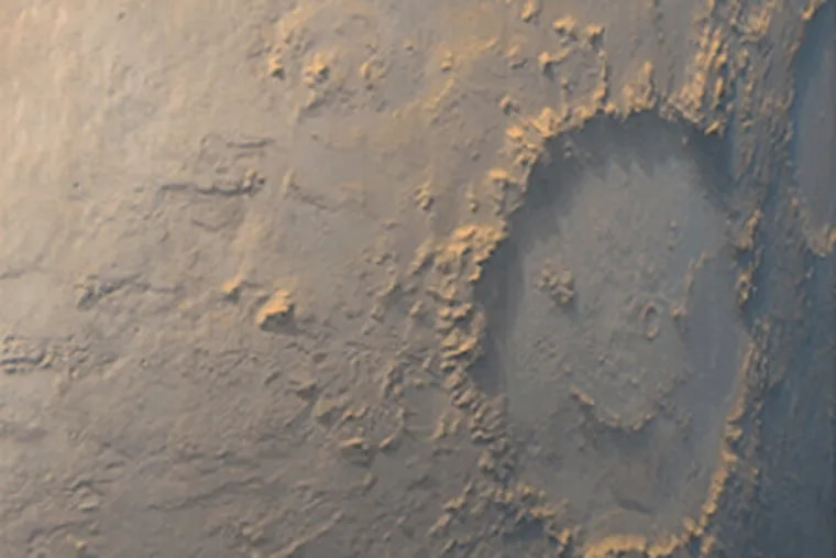 """The """"Happy Face Crater"""" was photographed by a Mars orbiter in 1999."""