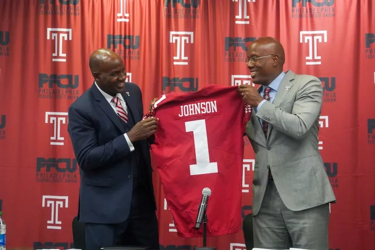 Arthur Johnson, left, the new Athletic Director and Vice President of Temple and president Jason Wingard hold up a jersey during a news conference on Thursday.