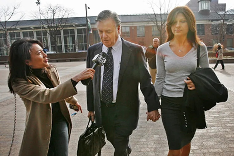 Former Pa. State Sen. Vincent J Fumo is interviewed by a news reporter as he and girlifriend Carolyn Zinni arrive this morning at the U.S. Courthouse in Philadelphia. (Alejandro A. Alvarez / Staff Photographer)