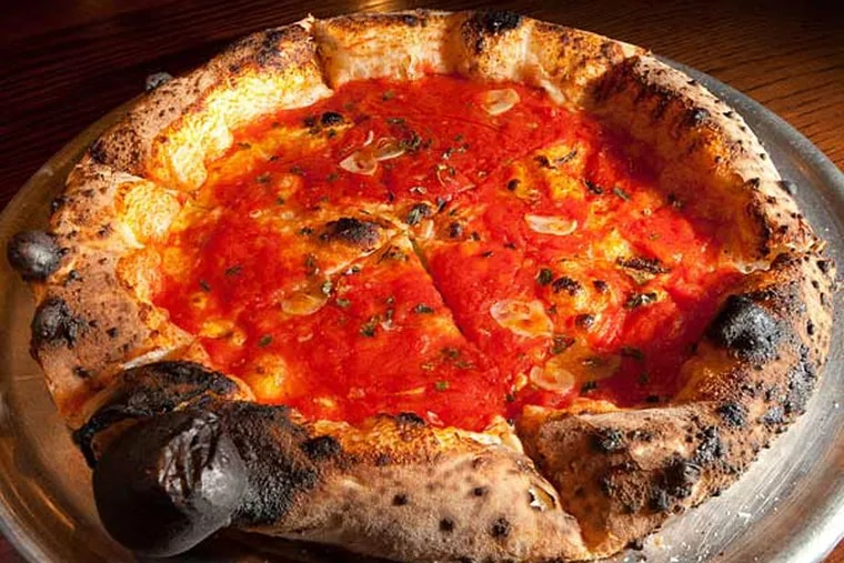 Contender for the city's best: A simple marinara pie topped with hand-crushed tomatoes, slivered garlic, and oregano at Pizzeria Vetri.