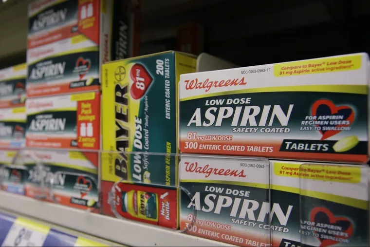 Packages of aspirin fill the shelves of a drugstore, Tuesday, Aug. 11, 2009 in Chicago.
