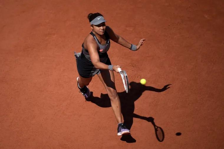 Japan's Naomi Osaka returns the ball to Romania's Patricia Maria Tig during their first round match at the Roland Garros stadium on Sunday.