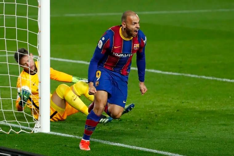 Martin Braithwaite celebrates scoring a goal for Barcelona, where he's teammates with global superstar Lionel Messi and marquee Americans Sergiño Dest and Konrad de la Fuente.