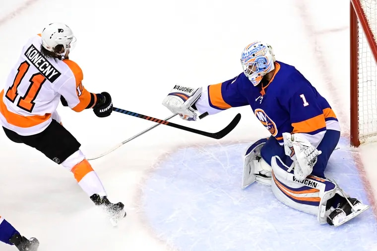 Flyers forward Travis Konecny is stopped by Islanders goaltender Thomas Greiss during the first period of Game 4.