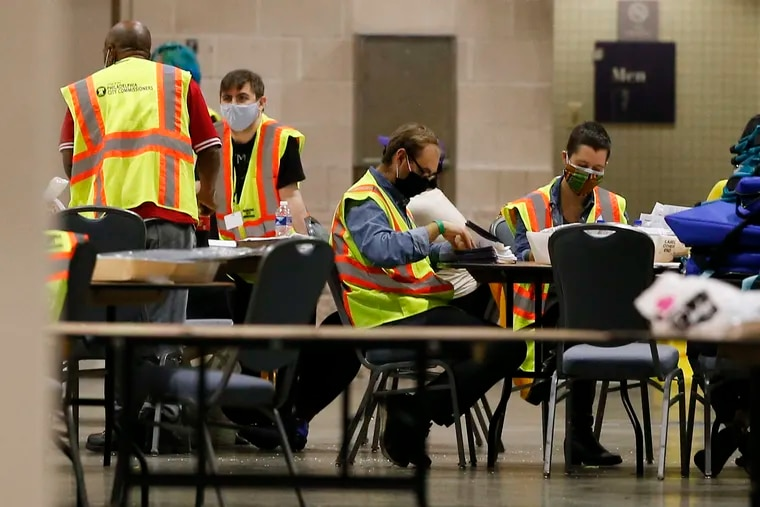 Workers processing mail ballots at the Pennsylvania Convention Center in Philadelphia on Nov. 6.