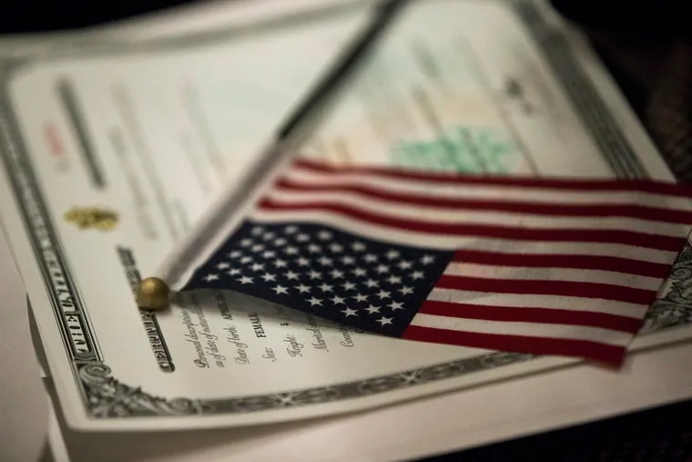 An American flag rests on a Certificate of Citizenship during a naturalization ceremony held at the Lower East Side Tenement Museum in 2016. Now President Biden has proposed a plan that would allow 11 million undocumented people in the United States to become American citizens.
