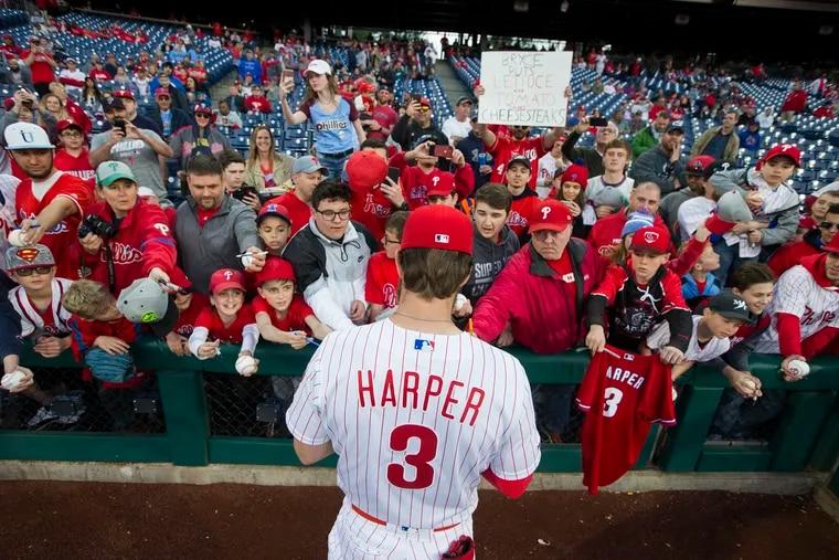 Bryce Harper signing autographs for Phillies fans at Citizens Bank Park last April.