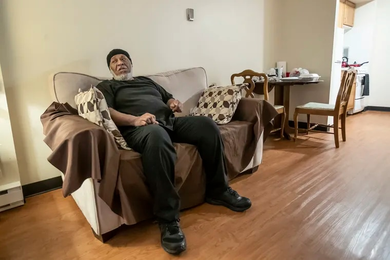 Purvis Wright, 62, relaxes on the couch after he returns to his apartment on the second floor at New Courtland Square residences on the grounds of Germantown Home.