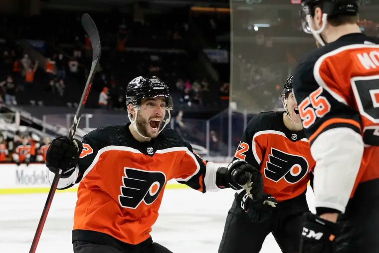 Flyers defenseman Shayne Gostisbehere is about to excitedly maul Samuel Morin after Morin's first career goal on Saturday helped the Flyers beat the Rangers, 2-1.