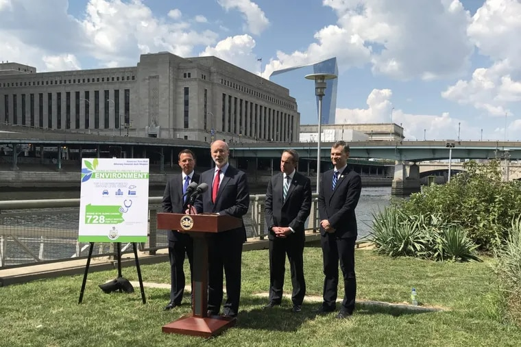 Pennsylvania Gov. Wolf (at lectern) and Attorney General Josh Shapiro (left)  announce the state was joining with 14 other states in a lawsuit.