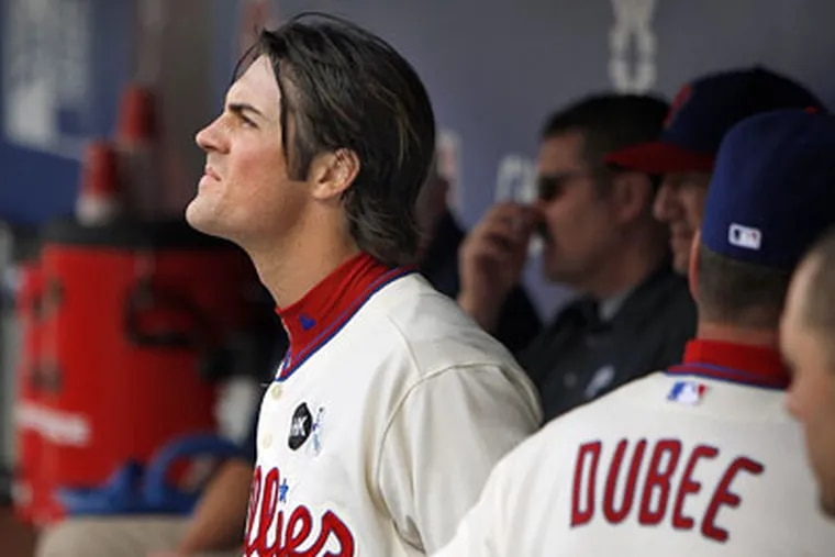 Cole Hamels looks out from the dugout after pitching the eigth inning Sunday. The Orioles scored their second run off of Hamels as they beat the Phillies 2-1 at Citizens Bank Park. (David Maialetti / Staff Photographer)