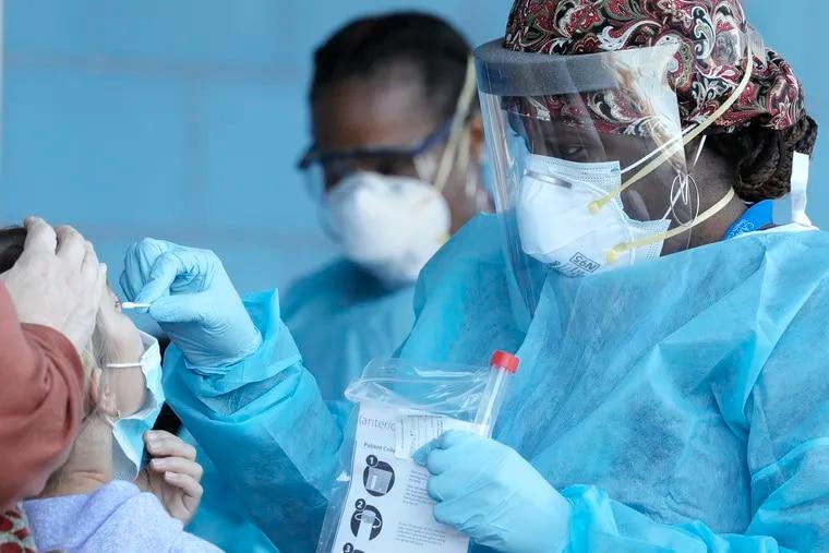 Nurse Teesha Cooper performs a coronavirus test at CAMcare Health Corp. in Camden in November.