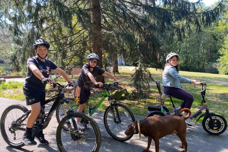 Born with spinal muscular atrophy, Allison Heinrich (right) has missed out on a lot of activities with her siblings. But with a new electric tricycle, she can now participate in family bike rides, something that's been life-changing for the whole family, says Heinrich's mom Kim.