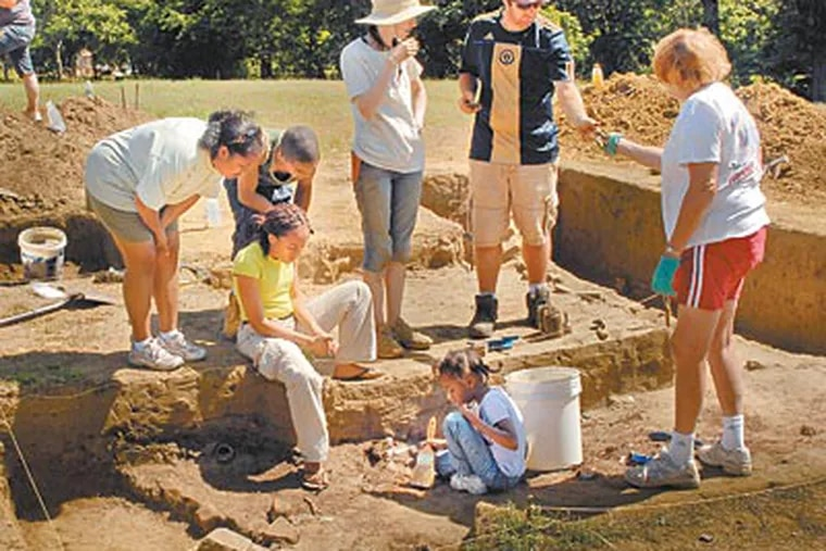 Christopher Barton (second from right), site manager and Temple University archaeological doctoral student, working with staff and volunteers at the Timbuctoo historical excavation in Westampton on Wednesday. (TOM GRALISH / Staff Photographer)