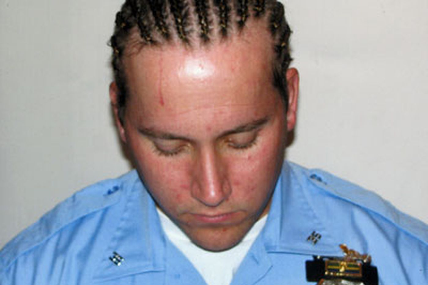 Cop with cornrows pulled from street duty