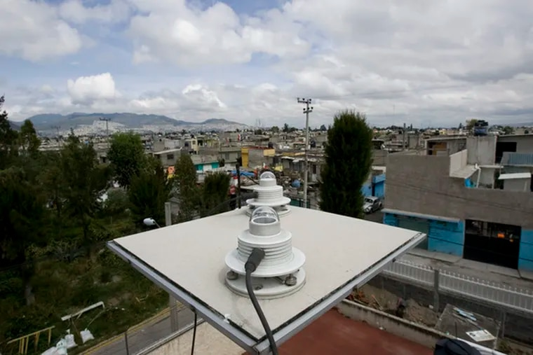 sits on a Mexico City rooftop. Efforts to reduce pollution intensified in the early 1990s.