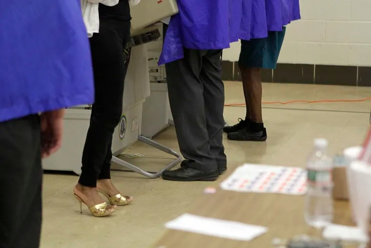Voters in booths at Thomas G. Morton school on 2015 Primary Election Day in Philadelphia.