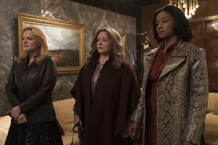 """ELISABETH MOSS as Claire, MELISSA McCARTHY as Kathy and TIFFANY HADDISH as Ruby in New Line Cinema's mob drama """"The Kitchen,"""" a Warner Bros. Pictures release."""