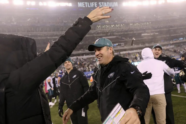 Eagles head coach Doug Pederson celebrates as he leaves the field after Sunday's win.