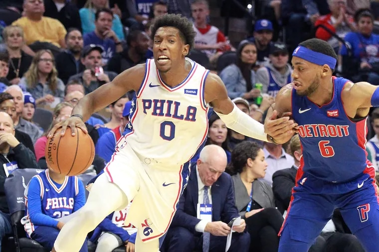 Josh Richardson, left, of the Sixers drives to the basket against Bruce Brown of the Pistons during the 1st half of their NBA preseason game at the Wells Fargo Center on Oct.15, 2019.