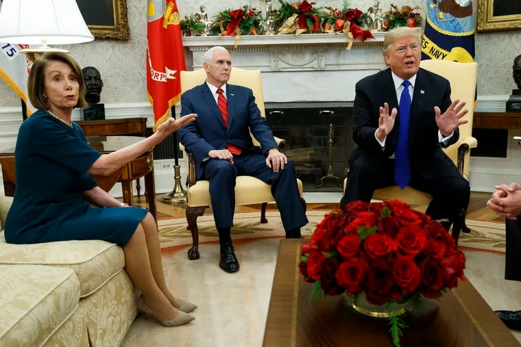 Vice President Mike Pence, center, looks on as House Minority Leader Rep. Nancy Pelosi, D-Calif., argues with President Donald Trump during a meeting in the Oval Office of the White House, Tuesday, Dec. 11, 2018, in Washington. (AP Photo/Evan Vucci)