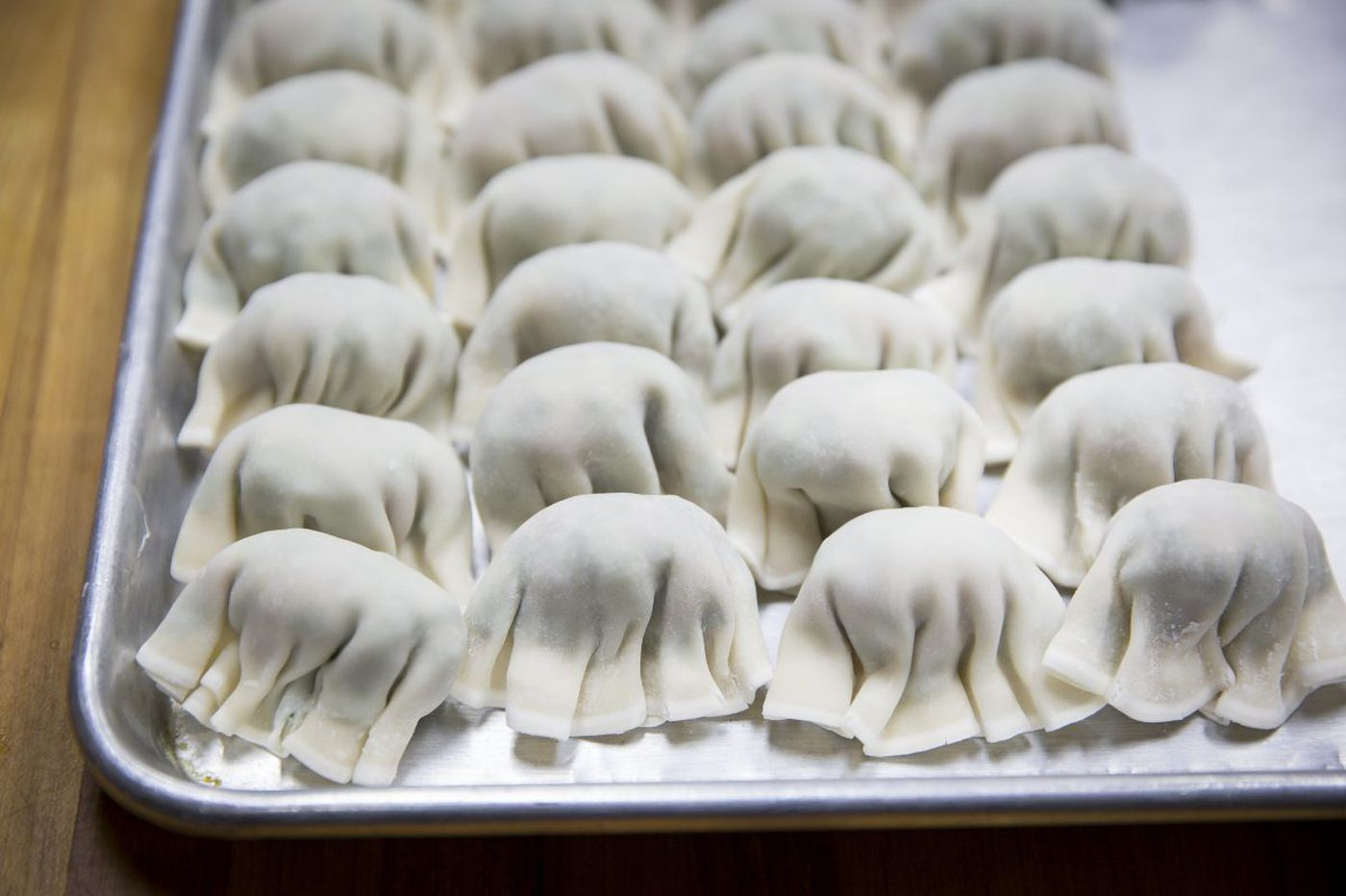 Celebrating Chinese New Year: Dumplings for wealth and noodles for a long life