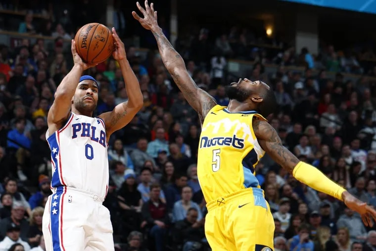 Sixers' Jerryd Bayless, left, goes up for a three-point basket over Denver Nuggets guard Will Barton in the second half.