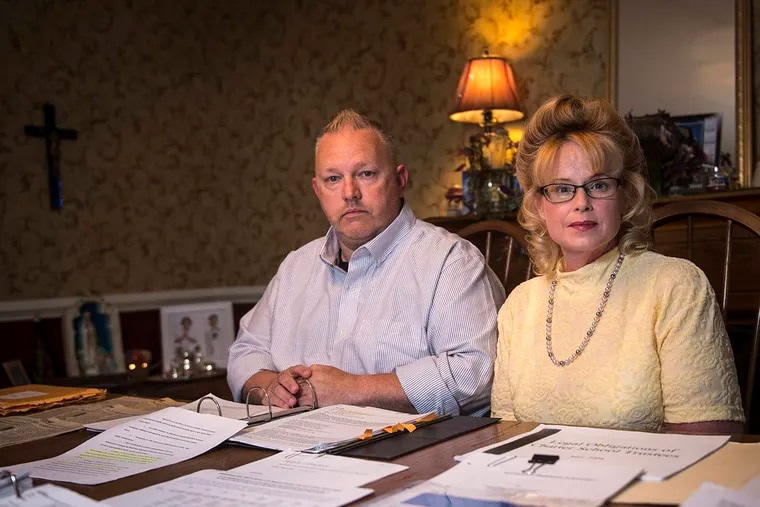 Angelique and Ira Smith in 2016 sit in front of documents and files from a defamation case that lasted more than seven years before being dismissed.