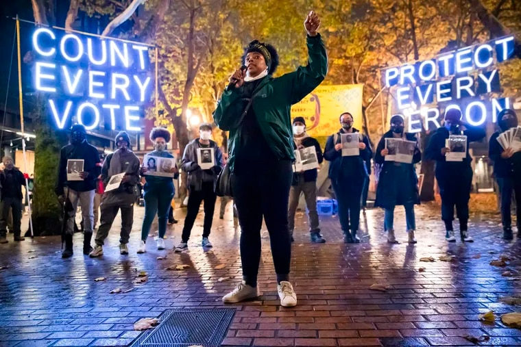 Travonna Thompson-Wiley, with Black Action Coalition, speaks at the Count Every Vote - Protect Every Person rally and march in Occidental Park in Seattle in November 2020.