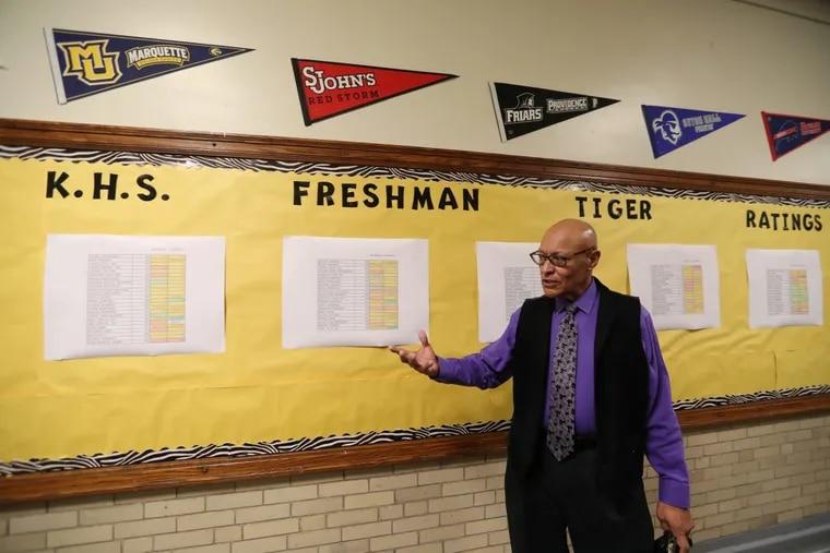 Principal Jose A. Lebron discusses the ninth grade progress wall at Kensington High School.