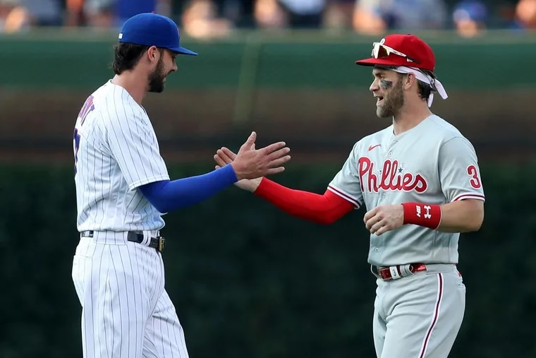 Kris Bryant and Bryce Harper greeted one another before a game at Wrigley Field on July 6.