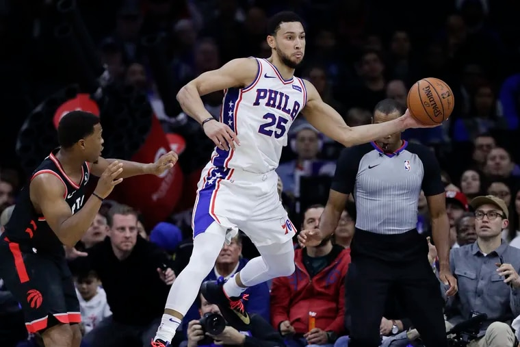 Sixers guard Ben Simmons saves the basketball from going out of bounds past Toronto Raptors guard Kyle Lowry.