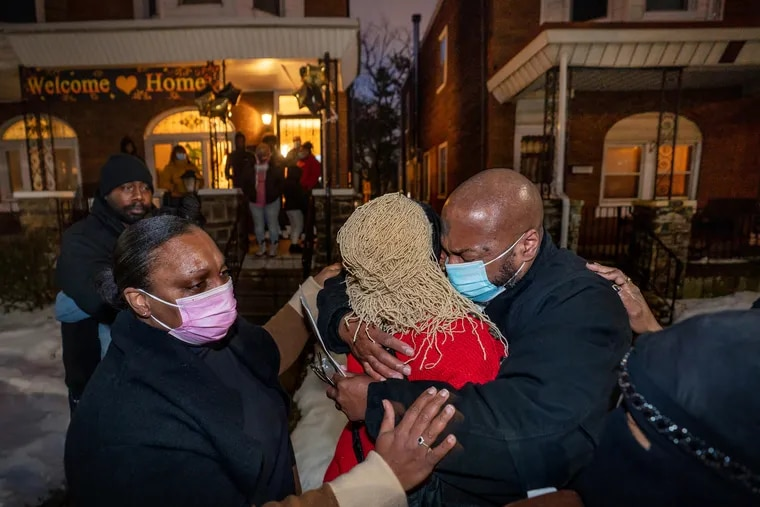 (Left to Right) Mildred Parker, and Maxine Mathis, hug their brother Christopher Williams, with his daughter Sherrie Bradley bottom right, as Williams arrived home from prison after being exonerated, he had been in prison for over 30 years, in Philadelphia, February 9, 2021.