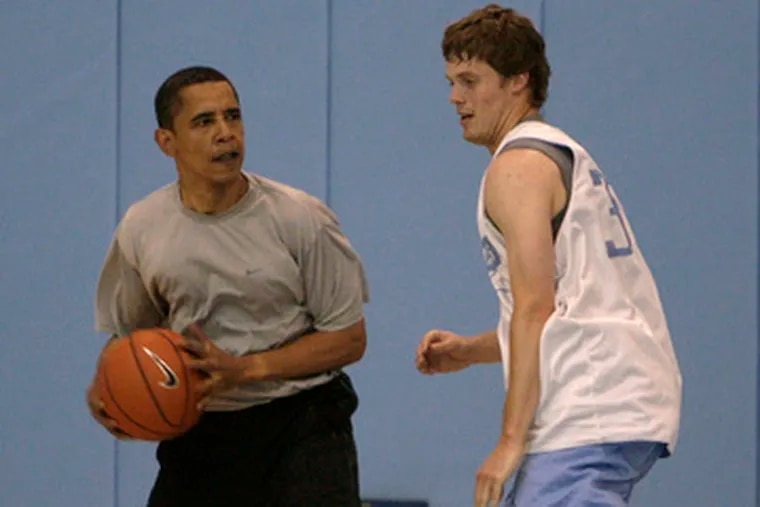 Guard Jack Wooten (right) of North Carolina found himself playing against an unusual opponent in April: Barack Obama.