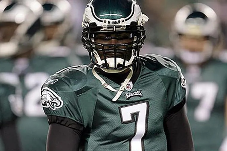 Michael Vick and several Eagles receivers held an informal practice yesterday in South Jersey. (Yong Kim/Staff file photo)
