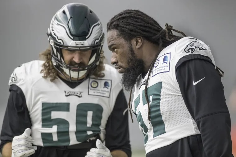 New Eagle linebacker Dannell Ellerbe, #57, right, listens to fellow linebacker Joe Walker, #59, left, during a special teams drill at the indoor practice at the NovaCare Center on Wednesday November 22, 2017.
