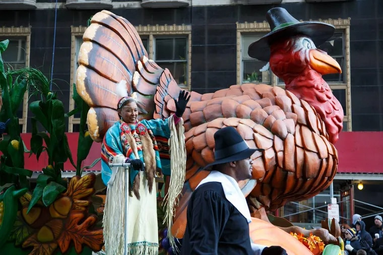 Parade participants wave from the first float of the 98th Annual 6ABC Dunkin' Donuts Thanksgiving Day Parade.
