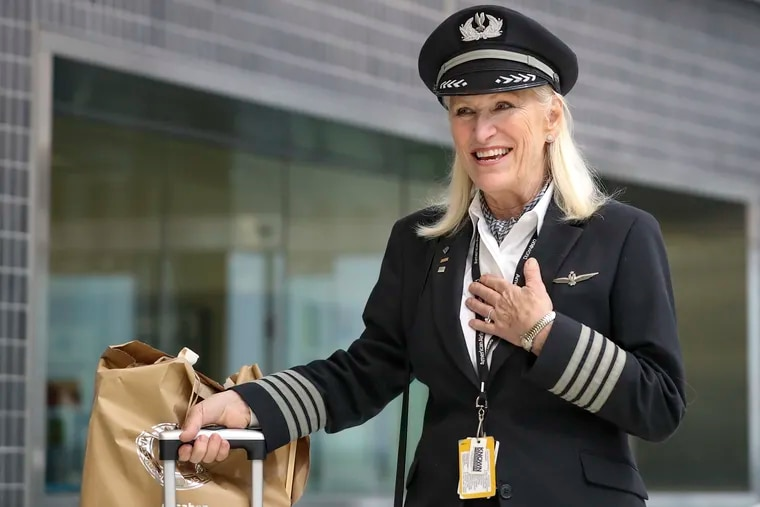 American Airlines Capt. Pati Marsh walks out to awaiting family and friends at the arrivals area of the international terminal at the Philadelphia International Airport. Marsh, who is retiring, made her last flight into Philadelphia from Madrid on Tuesday after 39 years of being a pilot.