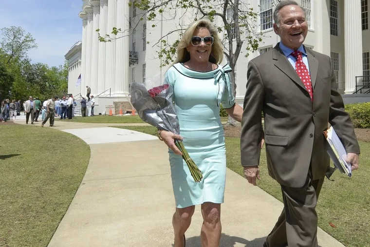 Roy Moore and his wife, Kayla, in April 26, 2017, outside the Capitol in Montgomery, Ala.