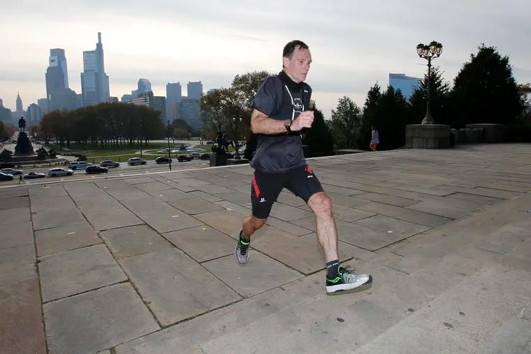 Mark Gibson running up the steps at the Philadelphia Museum of Art on Friday.